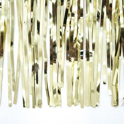 cortina de flecos dorada